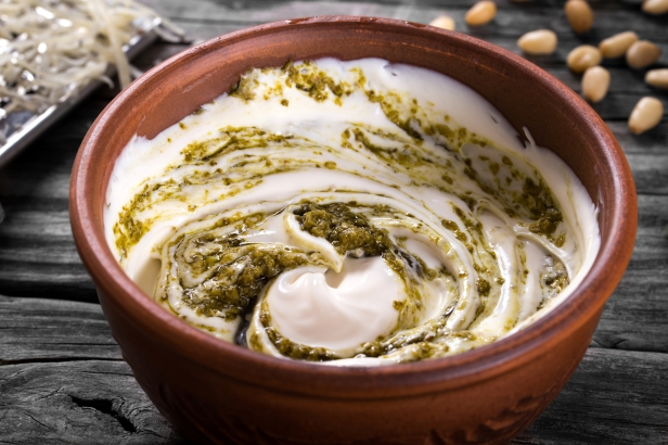 Pesto sauce with Greek yogurt in a bowl selective focus