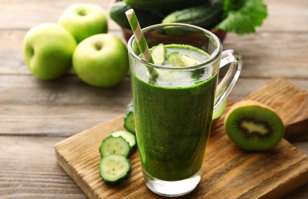 Green fresh healthy juice with fruits and vegetables on cutting