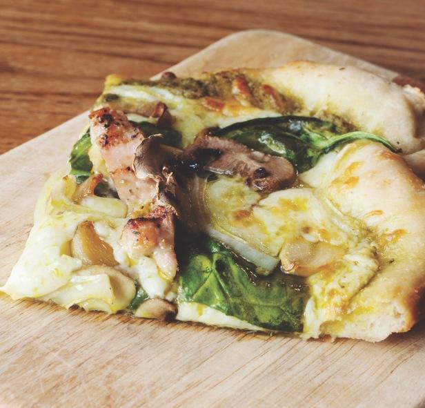 slice of pesto pizza