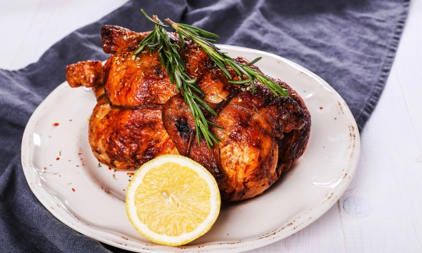 Food. Delicious roasted chicken on the table